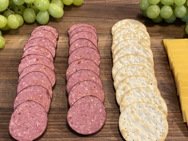 Mild Summer Sausage on Butcher Board